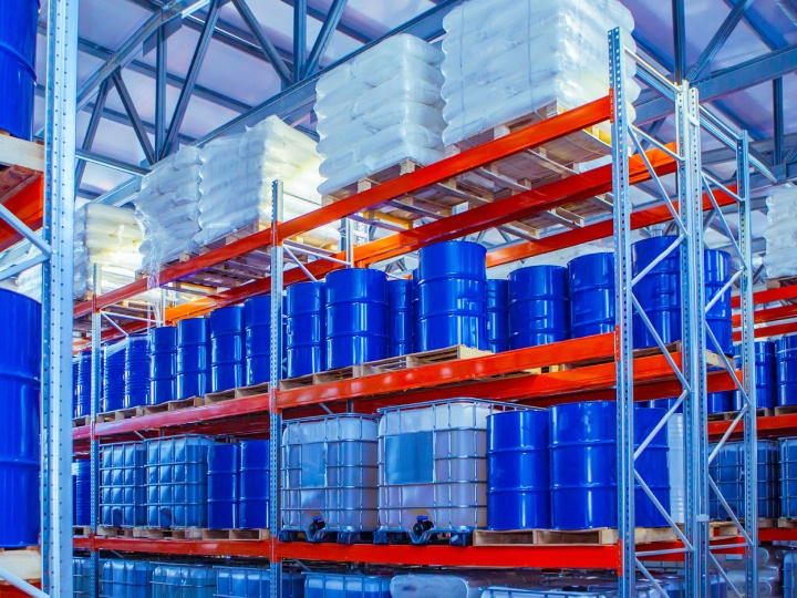 Blue barrels in a Quality Packing Services warehouse.